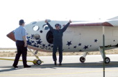 Michael W Melvill the pilot of the SpaceShipOne celebrates as Paul Allen walks over after he becomes the first pilot in a commercial craft to go into...