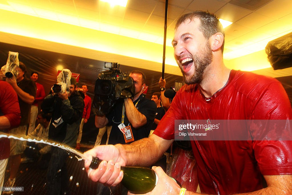 <a gi-track='captionPersonalityLinkClicked' href=/galleries/search?phrase=Michael+Wacha&family=editorial&specificpeople=10490716 ng-click='$event.stopPropagation()'>Michael Wacha</a> #52 of the St. Louis Cardinals celebrates in the locker room after their 6 to 1 win over the Pittsburgh Pirates in Game Five of the National League Division Series at Busch Stadium on October 9, 2013 in St Louis, Missouri.