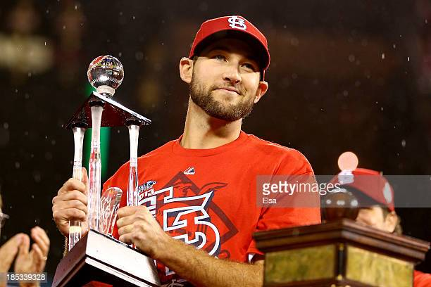Michael Wacha of the St Louis Cardinals celebrates with the NLCS MVP trophy after the Cardinals defeat the Los Angeles Dodgers 90 in Game Six of the...