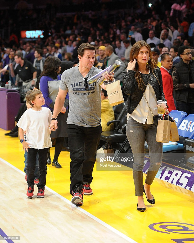 Michael Wahlberg, Mark Wahlberg and Rhea Durham attend a basketball game between the Miami Heat and the Los Angeles Lakers at Staples Center on January 17, 2013 in Los Angeles, California.