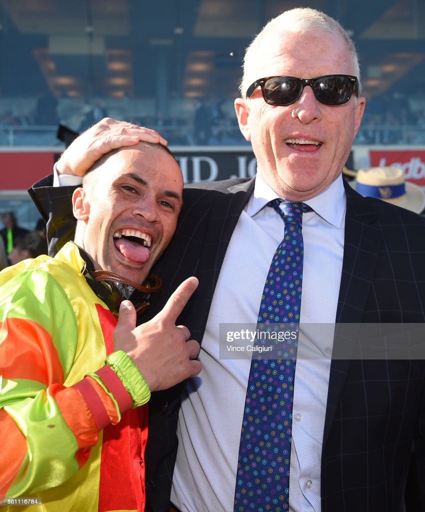 Michael Walker poses with trainer Mick Price after Mighty Boss won Race 8, Ladbrokes Caulfield Guineas during Melbourne Racing on Caulfield Guineas Day at Caulfield Racecourse on October 14, 2017 in Melbourne, Australia.
