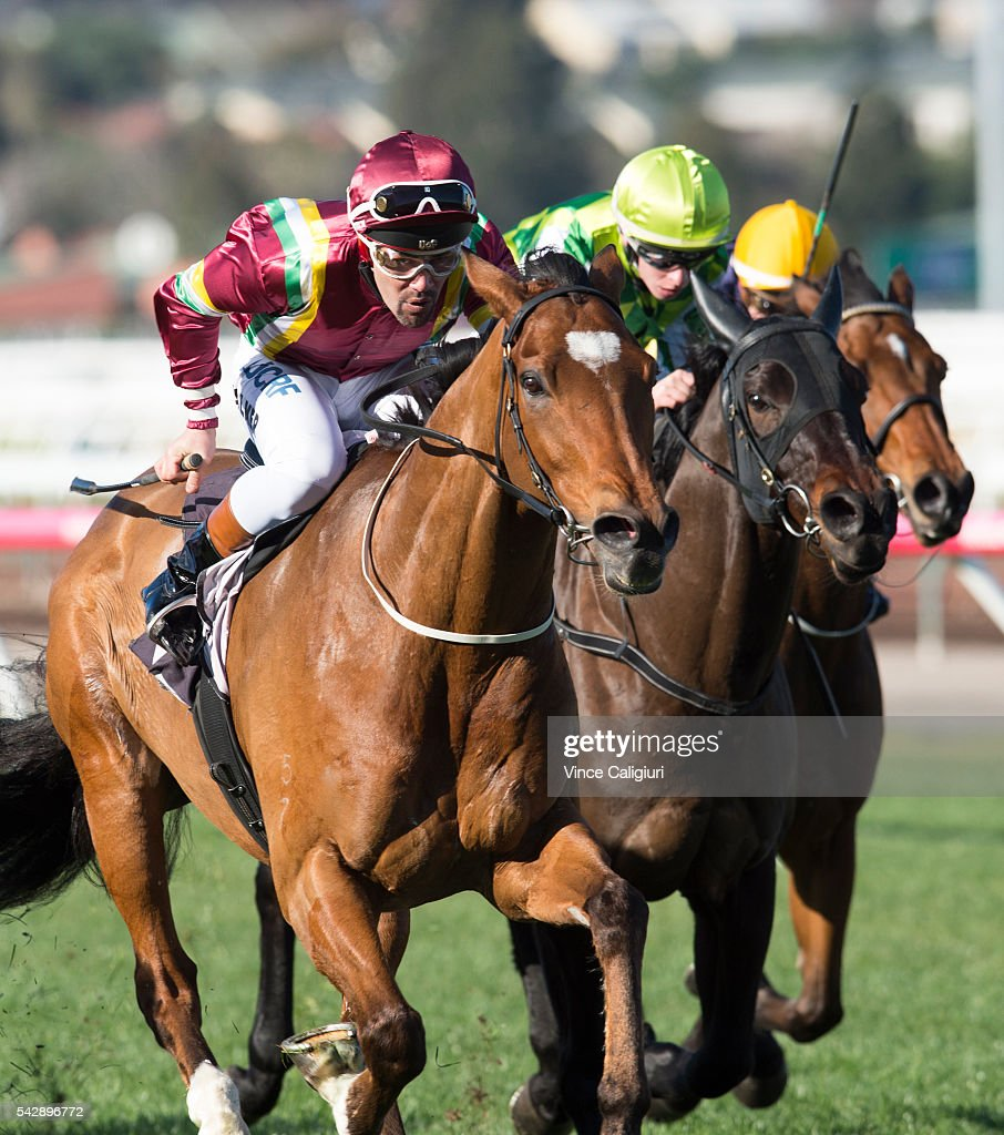 Michael Walker raises the whip riding Jacquinot Bay to win Race 5, during Melbourne Racing at Flemington Racecourse on June 25, 2016 in Melbourne, Australia.