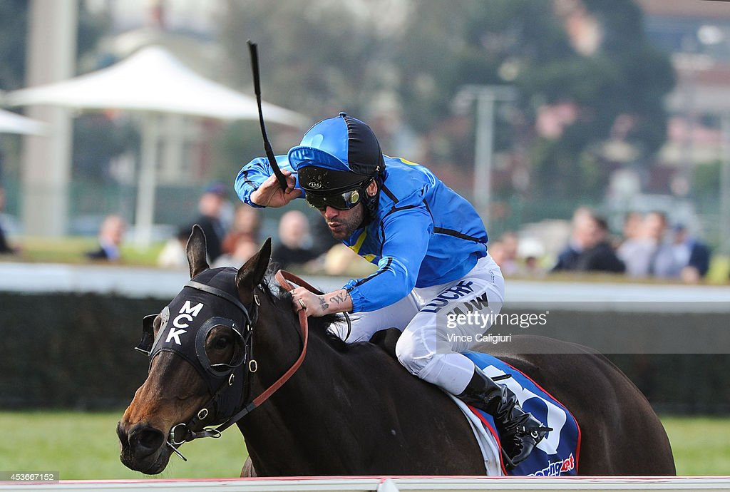 Michael Walker riding Good Value winning Race 3 during Melbourne Racing at Caulfield Racecourse on August 16 2014 in Melbourne Australia