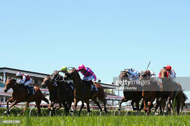 Michael Walker riding Tips and Beers leads the field across the line to win the Lanec Services Handicap during Melbourne Racing at Flemington...