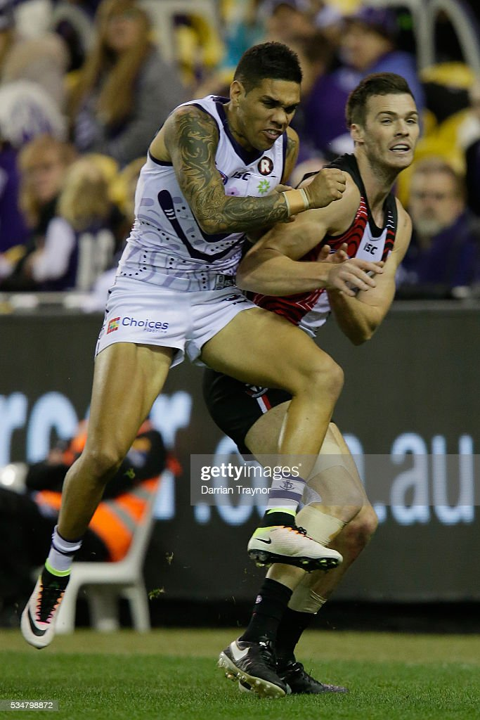 Michael Walters of the Dockers bumps Dylan Roberton of the Saints during the round 10 AFL match between the St Kilda Saints and the Fremantle Dockers at Etihad Stadium on May 28, 2016 in Melbourne, Australia.