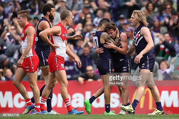 Michael Walters of the Dockers congratulates Lachie Neale after kicking a goal during the First AFL Qualifying Final match between the Fremantle...