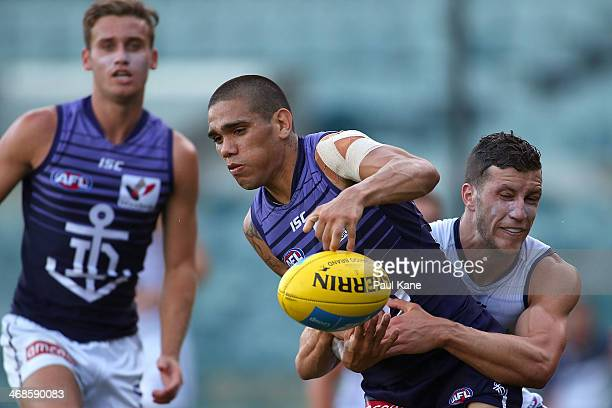 Michael Walters of the Dockers gets tackled by Sam Menegola during a Fremantle Dockers AFL IntraClub match at Patersons Stadium on February 11 2014...