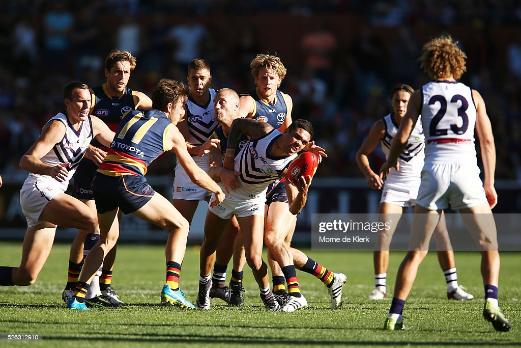 Michael Walters of the Dockers is tackled during the round six AFL match between the Adelaide Crows and the Fremantle Dockers at Adelaide Oval on April 30, 2016 in Adelaide, Australia.