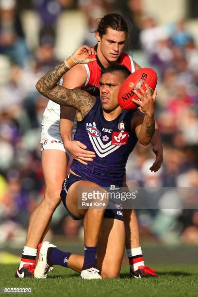 Michael Walters of the Dockers looks to move the ball on against Jack Steele of the Saints during the round 15 AFL match between the Fremantle...