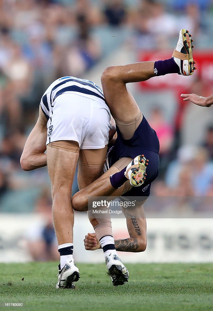 Michael Walters of the Fremantle Dockers tackles Joel Selwood of the Geelong Cats during the round one NAB Cup AFL match between the Fremantle Dockers and the Geelong Cats at Patersons Stadium on February 16, 2013 in Perth, Australia.