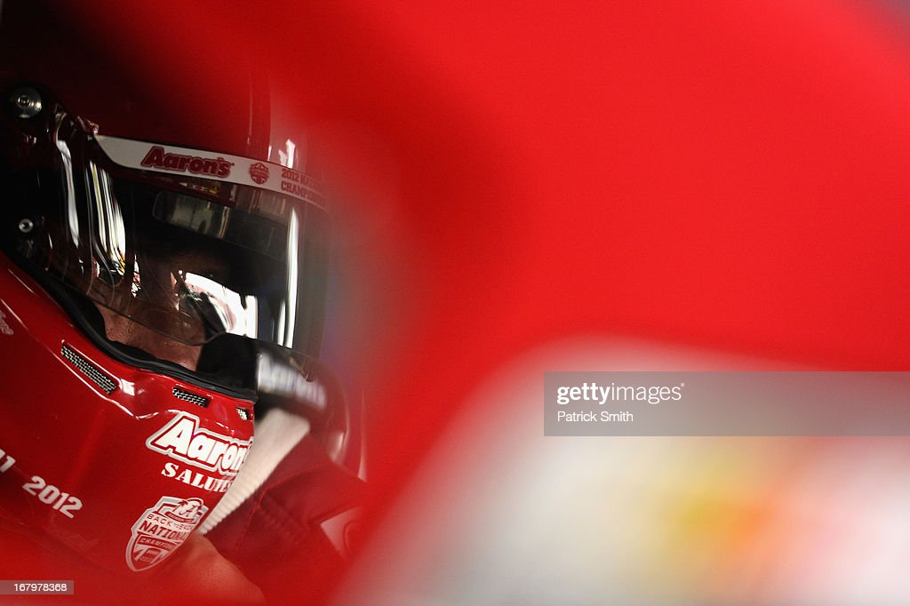 Michael Waltrip, driver of the #55 Aaron's Dream Machine - Alabama National Championship Toyota, looks on as he sits in his car during practice for the NASCAR Sprint Cup Series Aaron's 499 at Talladega Superspeedway on May 3, 2013 in Talladega, Alabama.