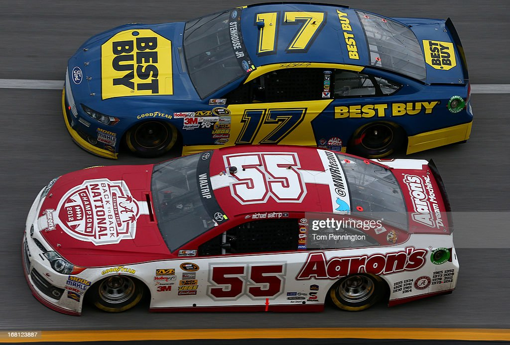 Michael Waltrip, driver of the #55 Aaron's Dream Machine / Alabama National Championship Toyota, leads Ricky Stenhouse Jr., driver of the #17 Best Buy Ford, during the NASCAR Sprint Cup Series Aaron's 499 at Talladega Superspeedway on May 5, 2013 in Talladega, Alabama.