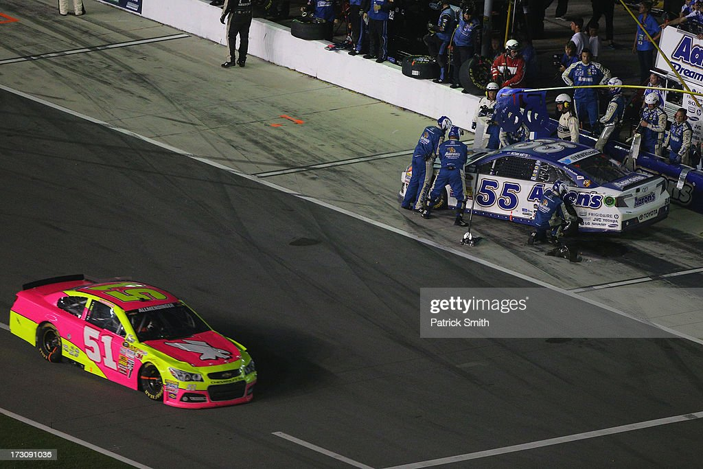 Michael Waltrip, driver of the #55 Aaron's Dream Machine Toyota, faces the wrong direction during a pit stop after spinning on pit road during the NASCAR Sprint Cup Series Coke Zero 400 at Daytona International Speedway on July 6, 2013 in Daytona Beach, Florida.