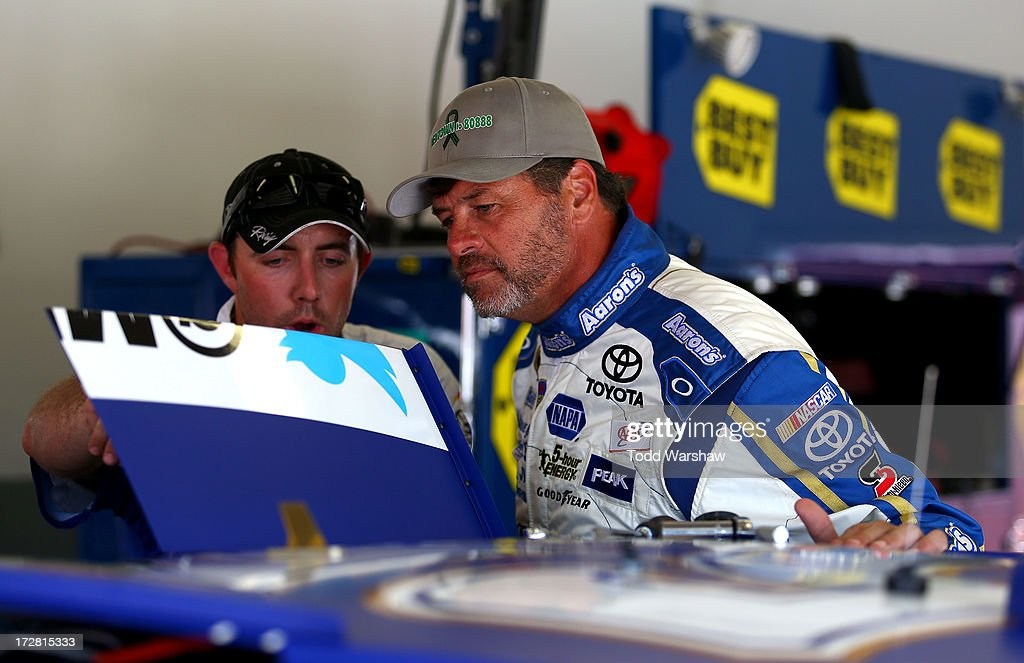 <a gi-track='captionPersonalityLinkClicked' href=/galleries/search?phrase=Michael+Waltrip&family=editorial&specificpeople=204621 ng-click='$event.stopPropagation()'>Michael Waltrip</a>, driver of the #55 Aaron's Dream Machine Toyota, inspects a roof flag on his car during practice for the NASCAR Sprint Cup Series Coke Zero 400 at Daytona International Speedway on July 4, 2013 in Daytona Beach, Florida.