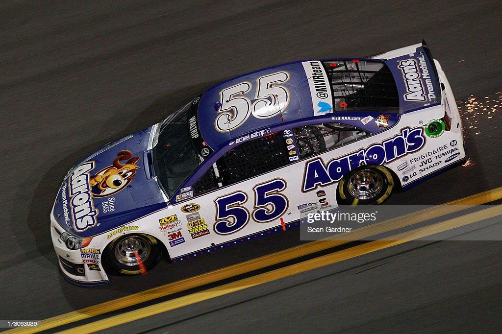 Michael Waltrip, driver of the #55 Aaron's Dream Machine Toyota, races during the NASCAR Sprint Cup Series Coke Zero 400 at Daytona International Speedway on July 6, 2013 in Daytona Beach, Florida.