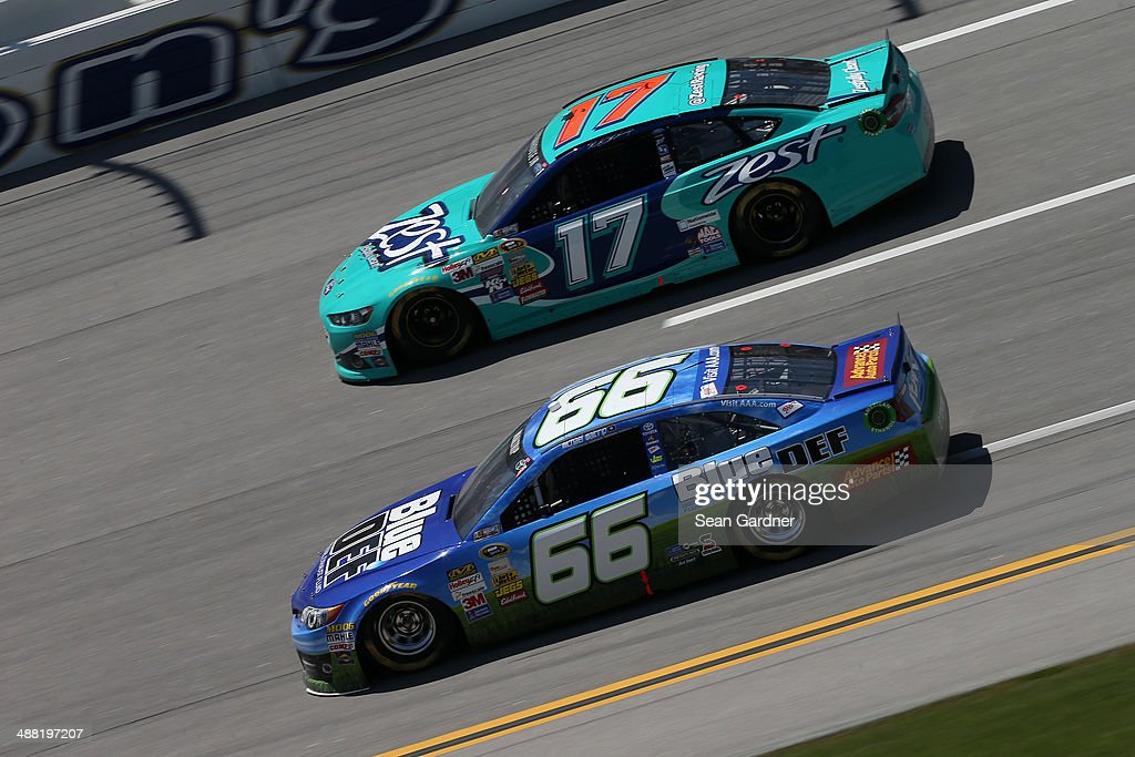 Michael Waltrip, driver of the #66 Blue / DEF Toyota, and Ricky Stenhouse Jr., driver of the #17 Zest Ford, race during the NASCAR Sprint Cup Series Aaron's 499 at Talladega Superspeedway on May 4, 2014 in Talladega, Alabama.
