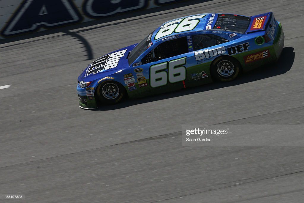 Michael Waltrip, driver of the #66 Blue / DEF Toyota, races during the NASCAR Sprint Cup Series Aaron's 499 at Talladega Superspeedway on May 4, 2014 in Talladega, Alabama.