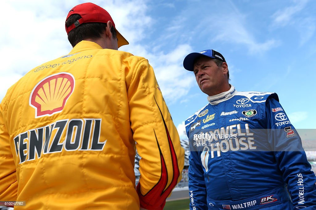 Michael Waltrip, driver of the #83 Maxwell House Toyota, talks with Joey Logano, driver of the #22 Shell Pennzoil Ford, on the grid during qualifying for the NASCAR Sprint Cup Series Daytona 500 at Daytona International Speedway on February 14, 2016 in Daytona Beach, Florida.