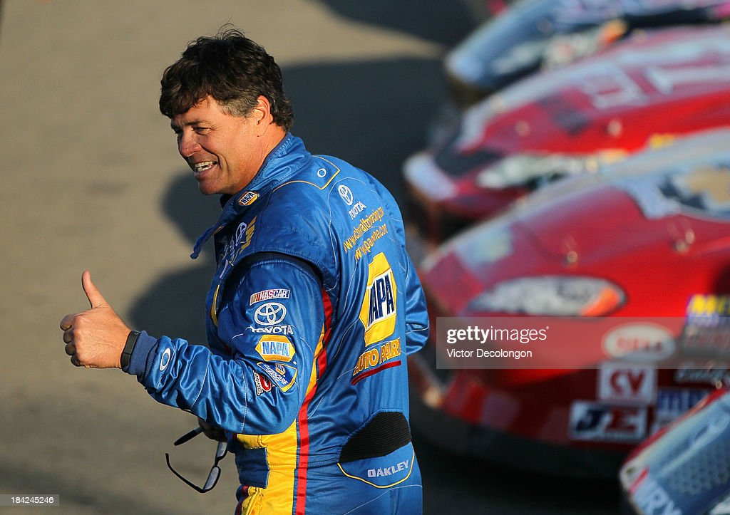 Michael Waltrip, driver of the #55 NAPA Filters Toyota, gives a thumbs up during the qualifying prior to the NASCAR K&N Toyota/NAPA Auto Parts 150 at All American Speedway on October 12, 2013 in Roseville, California.