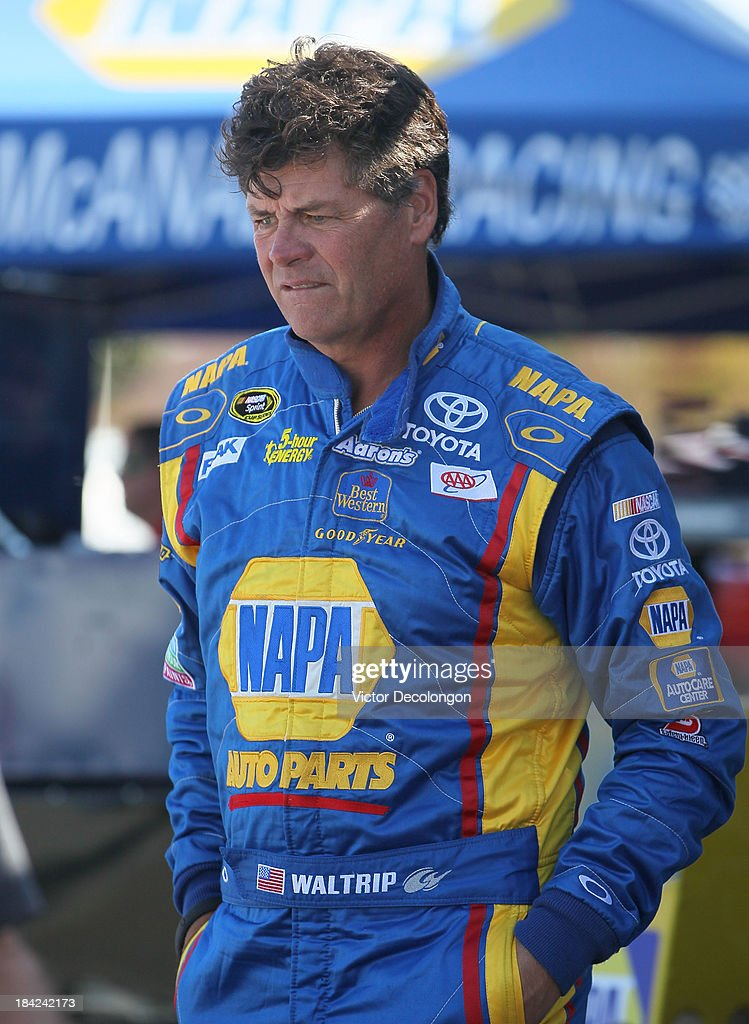 <a gi-track='captionPersonalityLinkClicked' href=/galleries/search?phrase=Michael+Waltrip&family=editorial&specificpeople=204621 ng-click='$event.stopPropagation()'>Michael Waltrip</a>, driver of the #55 NAPA Filters Toyota, looks on from the garage area during the final practice prior to the NASCAR K&N Toyota/NAPA Auto Parts 150 at All American Speedway on October 12, 2013 in Roseville, California.