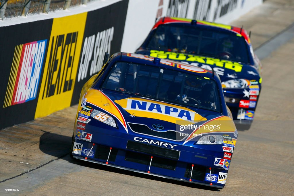Michael Waltrip driver of the NAPA Toyota leads Casey Mears driver of the National Guard/GMAC Chevrolet during practice for the NASCAR Nextel Cup...