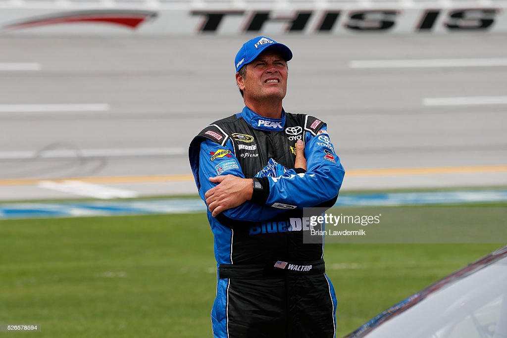 <a gi-track='captionPersonalityLinkClicked' href=/galleries/search?phrase=Michael+Waltrip&family=editorial&specificpeople=204621 ng-click='$event.stopPropagation()'>Michael Waltrip</a>, driver of the #55 Peak & BlueDEF Toyota, stands on the grid during qualifying for the NASCAR Sprint Cup Series GEICO 500 at Talladega Superspeedway on April 30, 2016 in Talladega, Alabama.