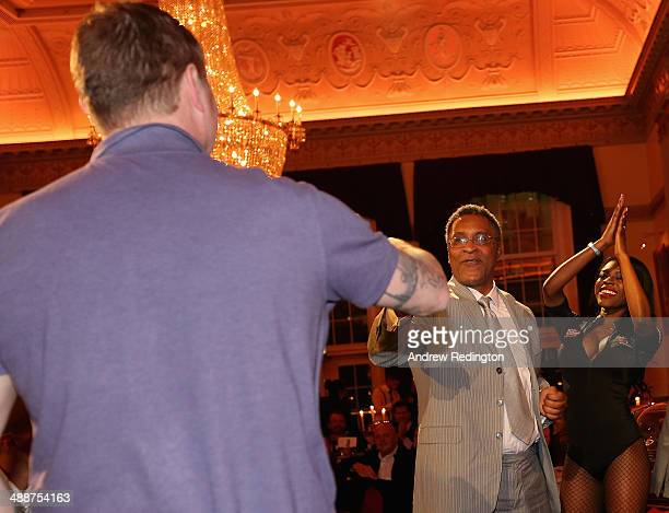 Michael Watson MBE former boxer bumps knuckles with Glenn McCrory former boxer during the Pound 4 Pound Charity fundraiser for Fight4change on May 7...