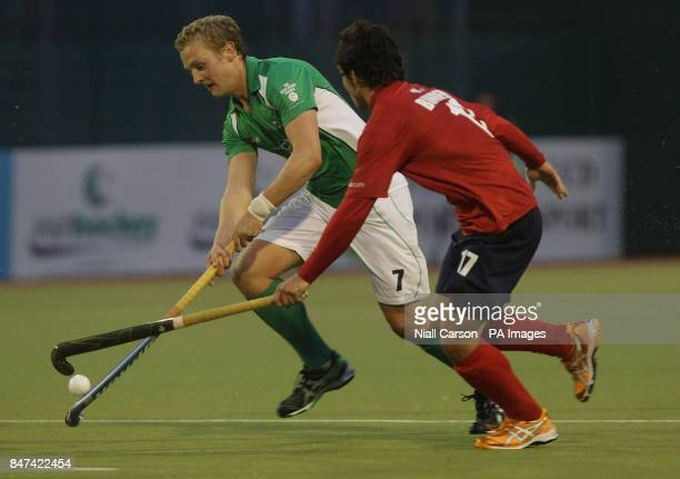 Michael Watt of Ireland and Fernando Binder of Chile during the FIH Olympic Games Qualifying Tournament at the Belfield Dublin