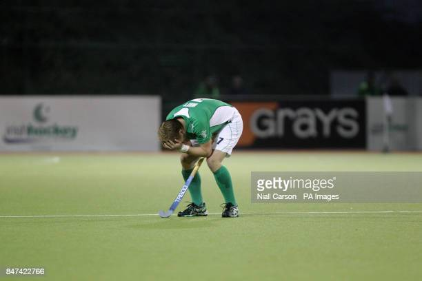 Michael Watts of Ireland suffers a knock to the head during the FIH Olympic Games Qualifying Tournament at the Belfield Dublin PRESS ASSOCIATION...