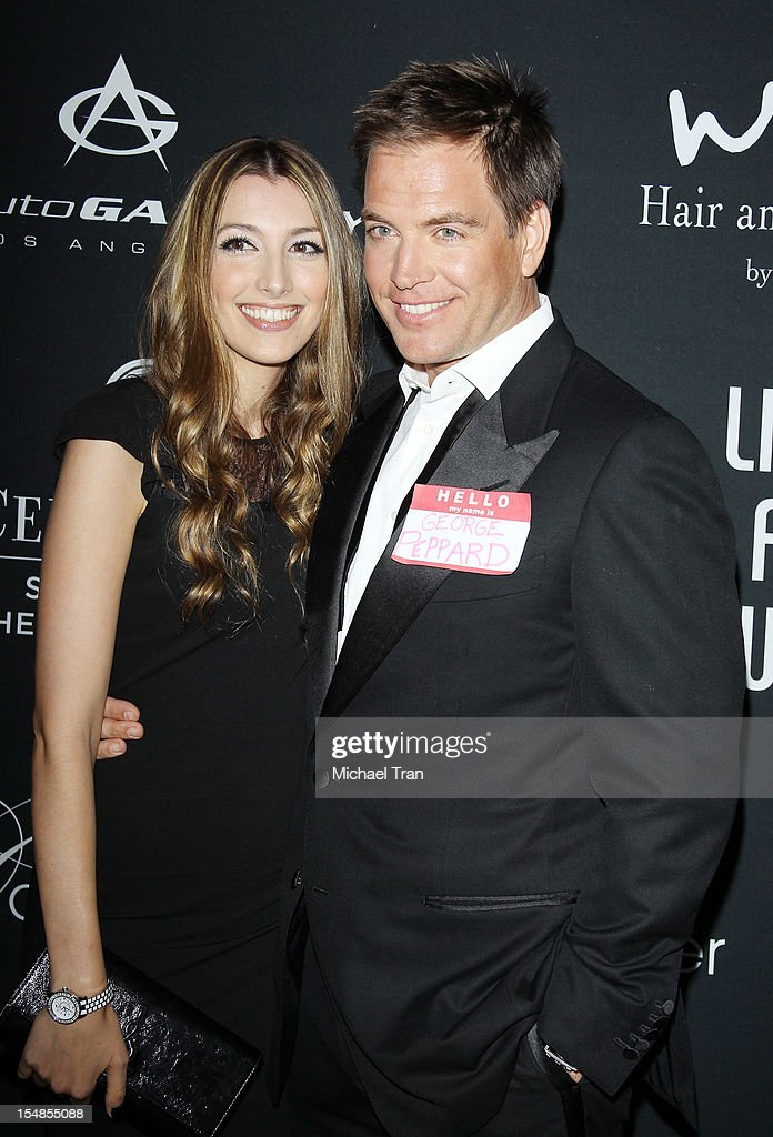 <a gi-track='captionPersonalityLinkClicked' href=/galleries/search?phrase=Michael+Weatherly&family=editorial&specificpeople=3321266 ng-click='$event.stopPropagation()'>Michael Weatherly</a> and his wife, Bojana Jankovic arrive at the 8th Annual Pink Party held at Hangar 8 on October 27, 2012 in Santa Monica, California.