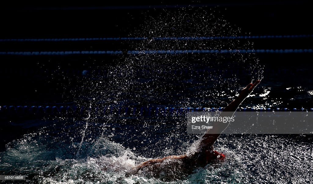 <a gi-track='captionPersonalityLinkClicked' href=/galleries/search?phrase=Michael+Weiss+-+Swimmer&family=editorial&specificpeople=14835132 ng-click='$event.stopPropagation()'>Michael Weiss</a> competes in the men's 200 meter backstroke B final during the 2014 Arena Grand Prix of Santa Clara at the George F. Haines International Swim Center on June 21, 2014 in Santa Clara, California.