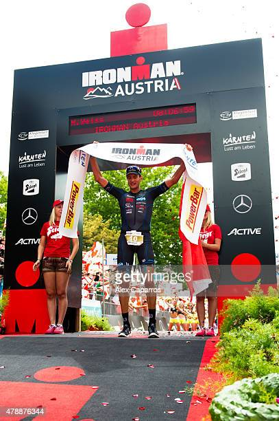 Michael Weiss of Austria celebrates after finishing in second place Ironman Klagenfurt on June 28 2015 in Klagenfurt Austria