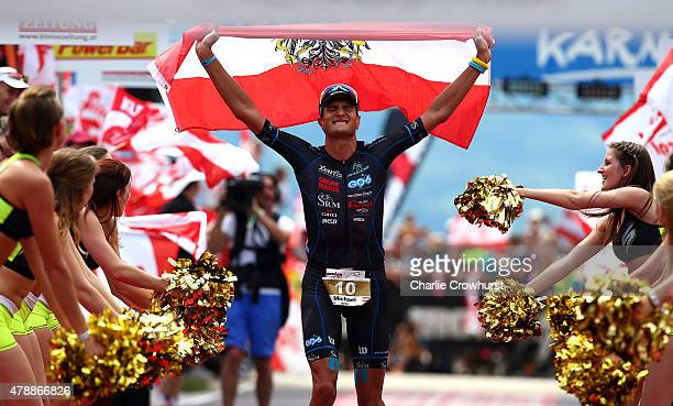 Michael Weiss of Austria celebrates second place in the mens race during Ironman Klagenfurt on June 28 2015 in Klagenfurt Austria