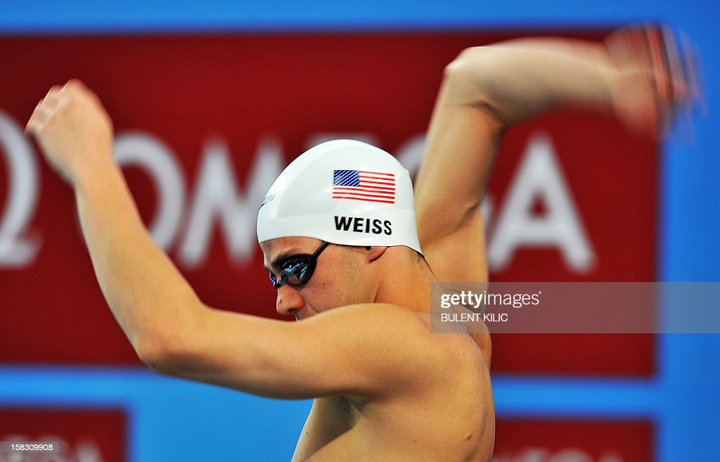 Michael Weiss of the US gestures during the men's 400m individual medley qualification on December 13, 2012 of the FINA World Short Course Swimming Championships in Istanbul.