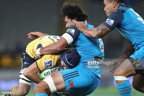 Michael Wells of the Brumbies is tackled by Steven Luatua of the Blues during the round 16 Super Rugby match between the Blues and the Brumbies at...