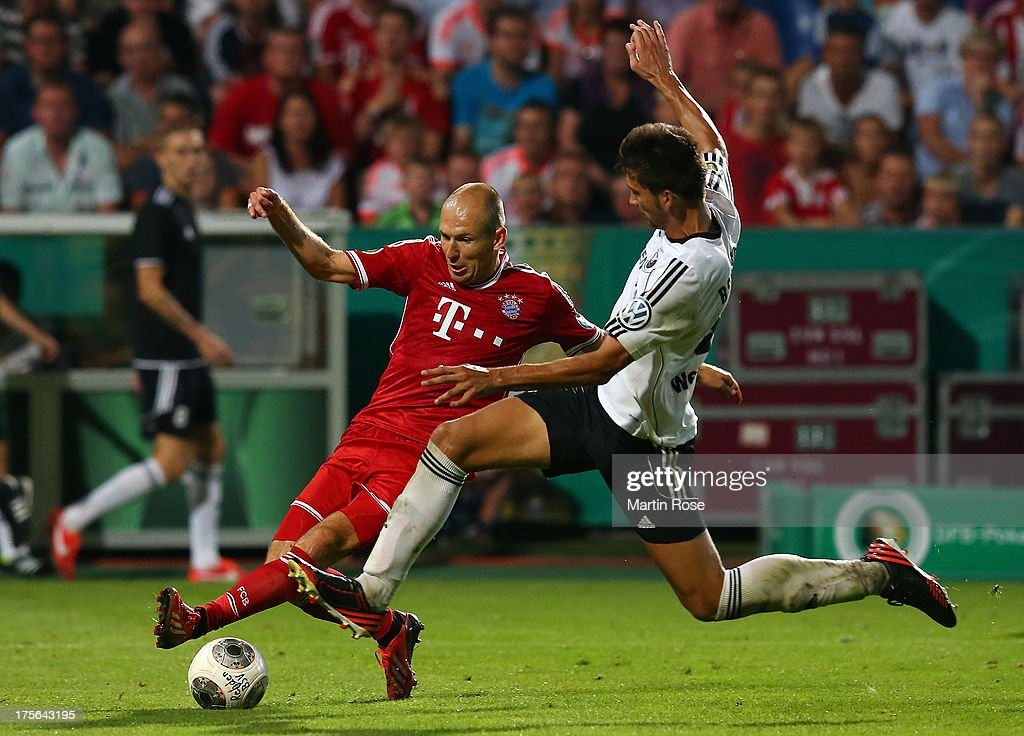 Michael Wessel (R) of Rehden and <a gi-track='captionPersonalityLinkClicked' href=/galleries/search?phrase=Arjen+Robben&family=editorial&specificpeople=194740 ng-click='$event.stopPropagation()'>Arjen Robben</a> (L) of Muenchen battle for the ball during the DFB Cup first round match between BSV SW Rehden and Bayern Muenchen at osnatel Arena on August 5, 2013 in Osnabrueck, Germany.