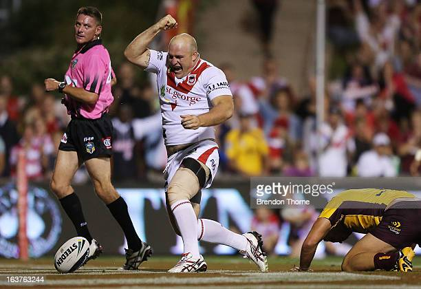 Michael Weyman of the Dragons celebrates after scoring the opening try for the Dragons during the round two NRL match between the St George Dragons...