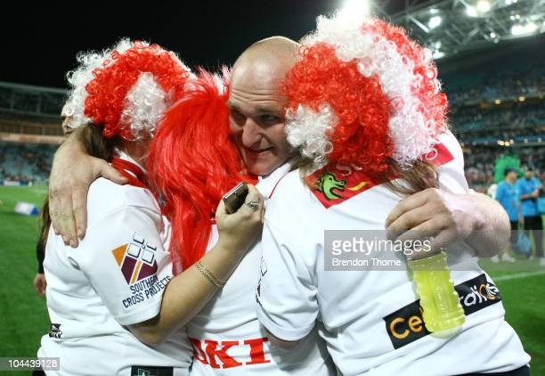 Michael Weyman of the Dragons celebrates with fans after victory over the Tigers during the Second NRL Preliminary Final match between the St George...