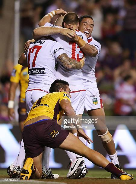 Michael Weyman of the Dragons celebrates with team mates after scoring the opening try during the round two NRL match between the St George Dragons...