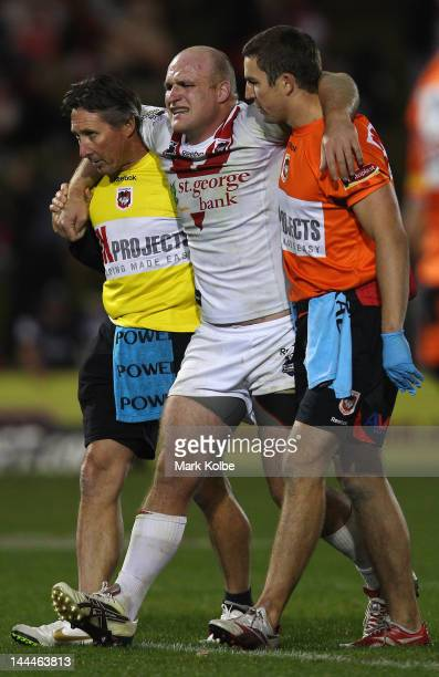 Michael Weyman of the Dragons is helped from the field with an injury during the round 10 NRL match between the Penrith Panthers and the St George...