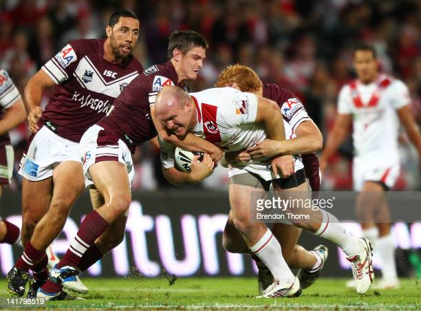 Michael Weyman of the Dragons is tackled by the Sea Eagles defence during the round four NRL match between the St George Illawarra Dragons and the...