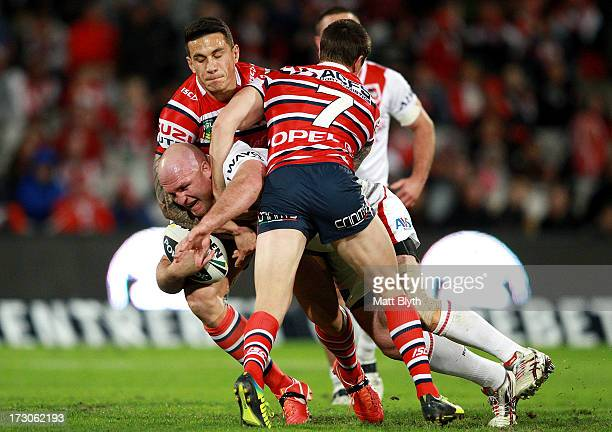 Michael Weyman of the Dragons is tackled during the round 17 NRL match between the St George Illawarra Dragons and the Sydney Roosters at WIN Jubilee...