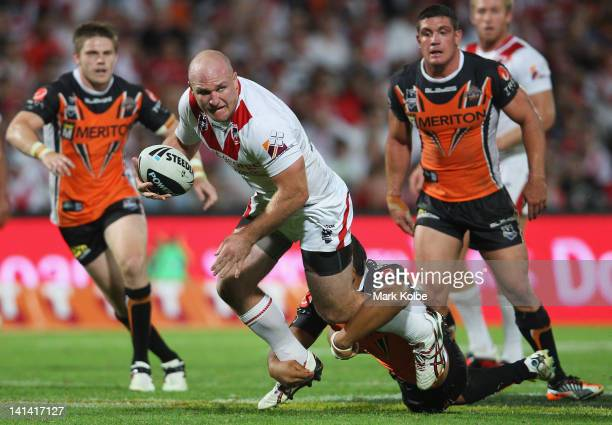 Michael Weyman of the Dragons is tackled during the round three NRL match between the St George Illawarra Dragons and the Wests Tigers at WIN Jubilee...