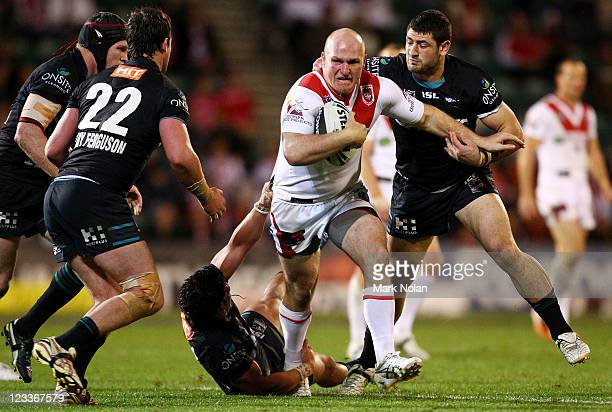Michael Weyman of the Dragons runs the ball during the round 26 NRL match between the St George Illawarra Dragons and the Penrith Panthers at WIN...