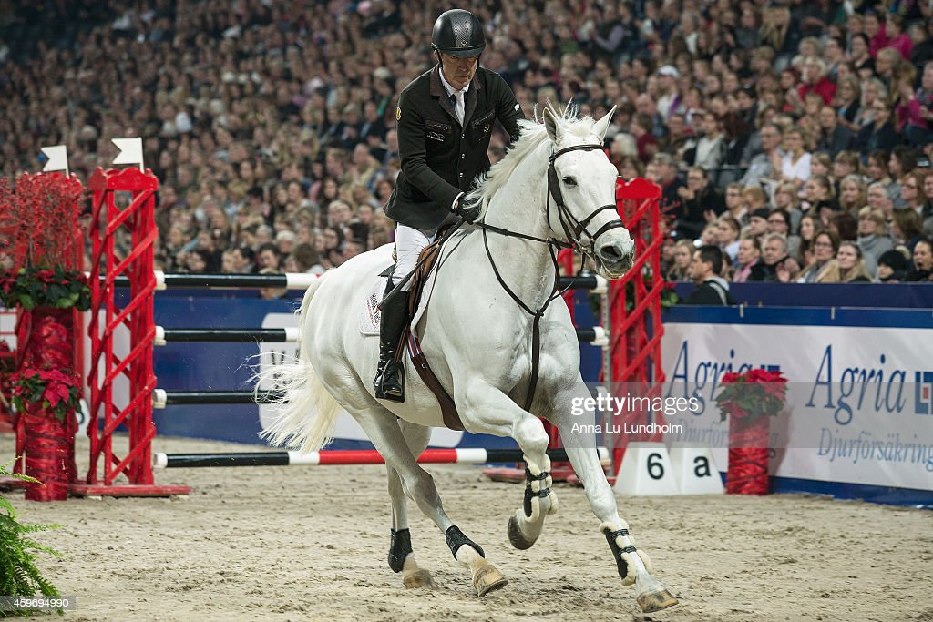<a gi-track='captionPersonalityLinkClicked' href=/galleries/search?phrase=Michael+Whitaker&family=editorial&specificpeople=607520 ng-click='$event.stopPropagation()'>Michael Whitaker</a> competing in the Carpe Diem Beds Trophy at Sweden International Horse Show 2014 at Friends Arena on November 28, 2014 in Stockholm, Sweden.
