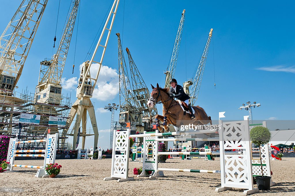 Michael Whitaker of Britain rides Viking at the Grand Prix of the sixth edition of Antwerp jumping, on April 28, 2013.