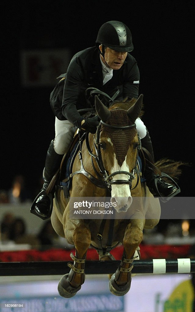 Michael Whitaker of Britain riding Viking competes in the international jumping competition Grand Prix equestrian event in Hong Kong on March 2, 2013. AFP PHOTO / Antony DICKSON