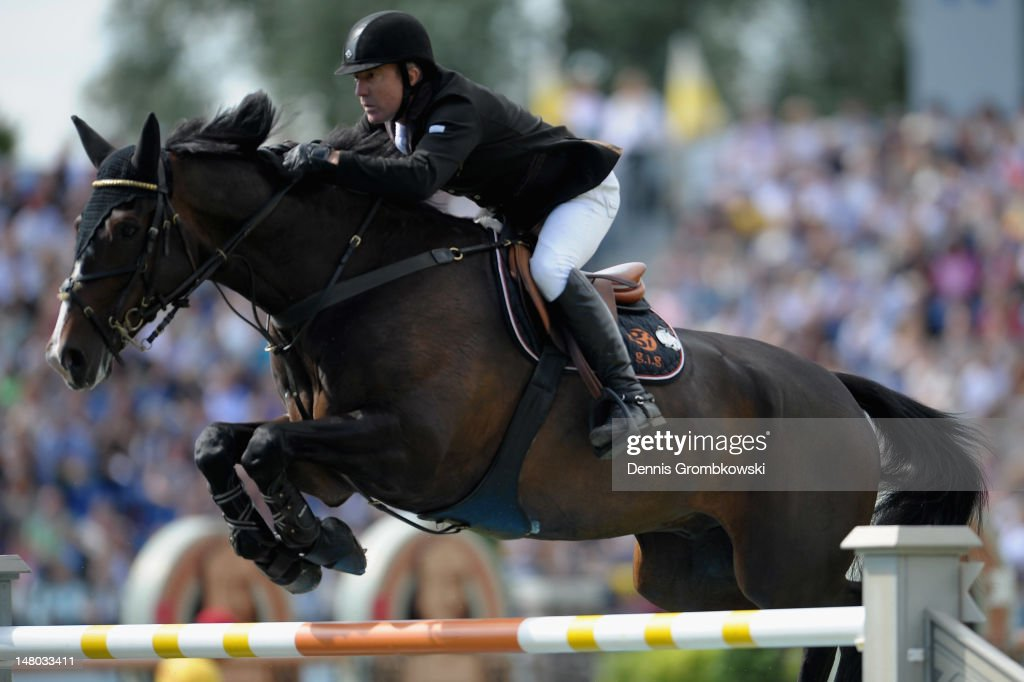 <a gi-track='captionPersonalityLinkClicked' href=/galleries/search?phrase=Michael+Whitaker&family=editorial&specificpeople=607520 ng-click='$event.stopPropagation()'>Michael Whitaker</a> of Great Britain and his horse Gig Amai compete in the Rolex Grand Prix jumping competition during day six of the 2012 CHIO Aachen tournament on July 8, 2012 in Aachen, Germany.