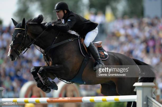 Michael Whitaker of Great Britain and his horse Gig Amai compete in the Rolex Grand Prix jumping competition during day six of the 2012 CHIO Aachen...