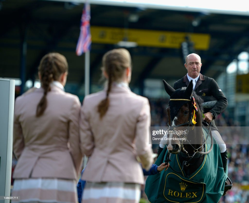 <a gi-track='captionPersonalityLinkClicked' href=/galleries/search?phrase=Michael+Whitaker&family=editorial&specificpeople=607520 ng-click='$event.stopPropagation()'>Michael Whitaker</a> of Great Britain celebrates on his horse Gig Amai after winning the Rolex Grand Prix jumping competition during day six of the 2012 CHIO Aachen tournament on July 8, 2012 in Aachen, Germany.